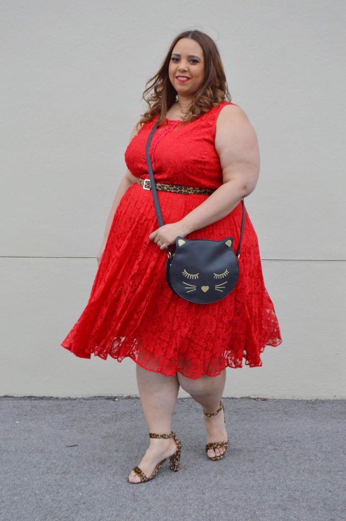 plus size blogger farrah estrella in a red dress
