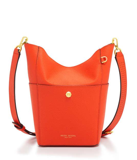henri bendel influencer hobo bucket bag in mandarin orange