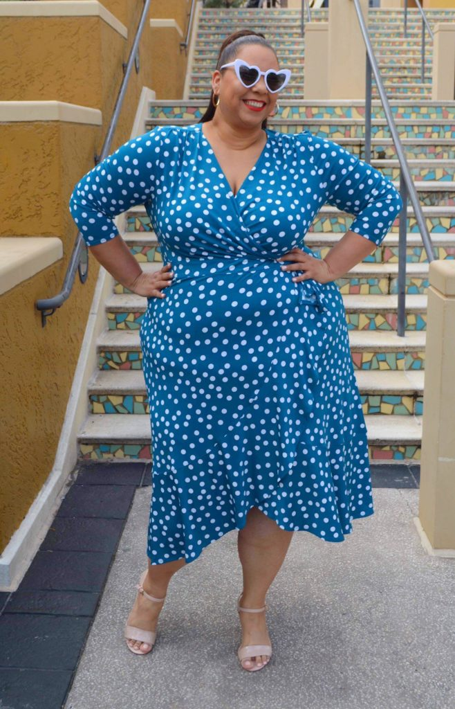 Tampa fashion blogger farrah estrella wearing a green wrap dress