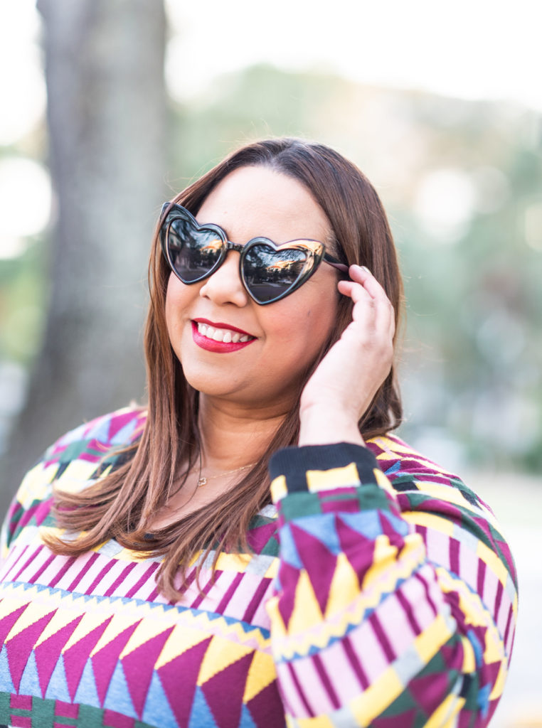 Farrah Estrella wearing heart shaped sunglasses