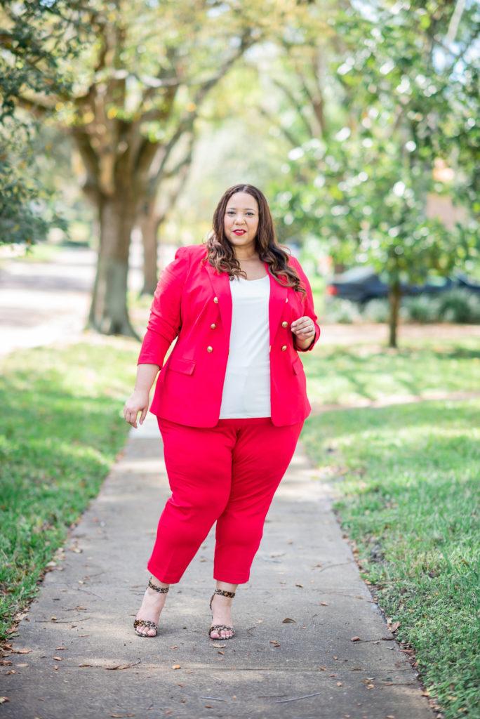 farrah estrella in a red suit