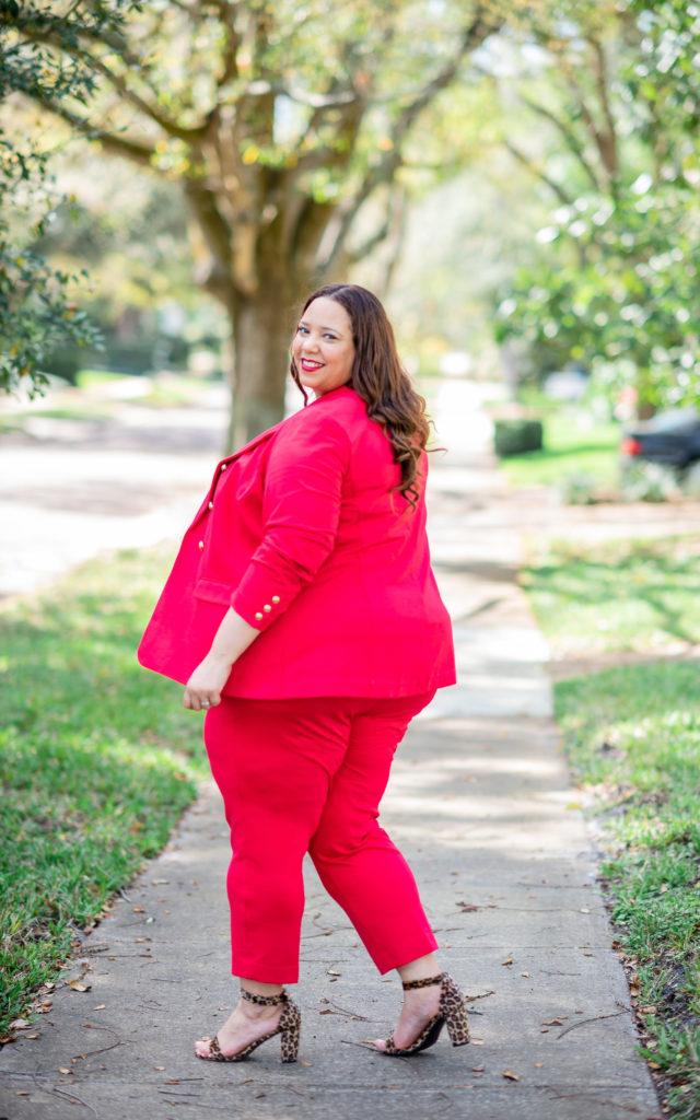 blogger farrah estrella in a red plus size suit