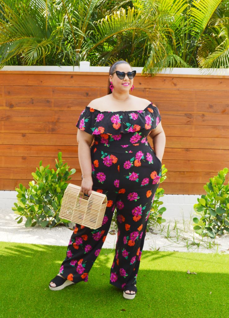 plus size blogger Farrah Estrella wearing a floral jumpsuit from Torrid