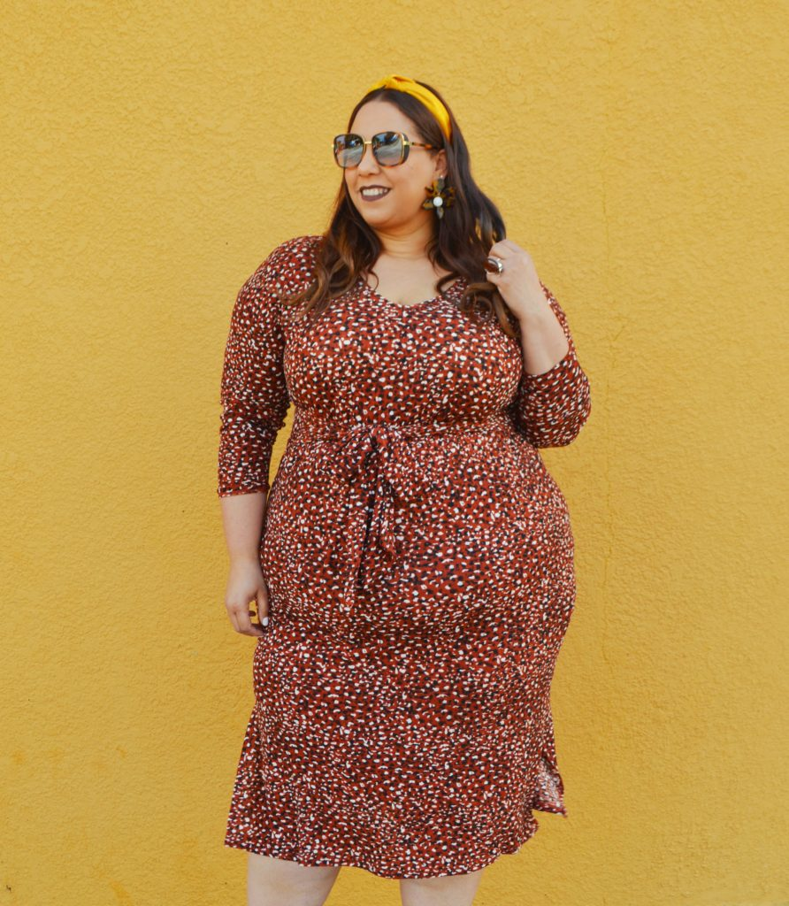 plus size fashion blogger farrah estrella wearing a leopard print dress