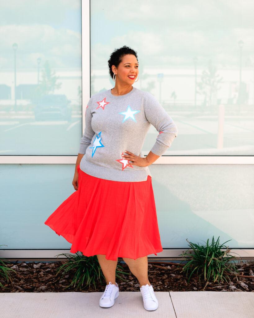 tampa influencer farrah estrella wearing a star print sweater