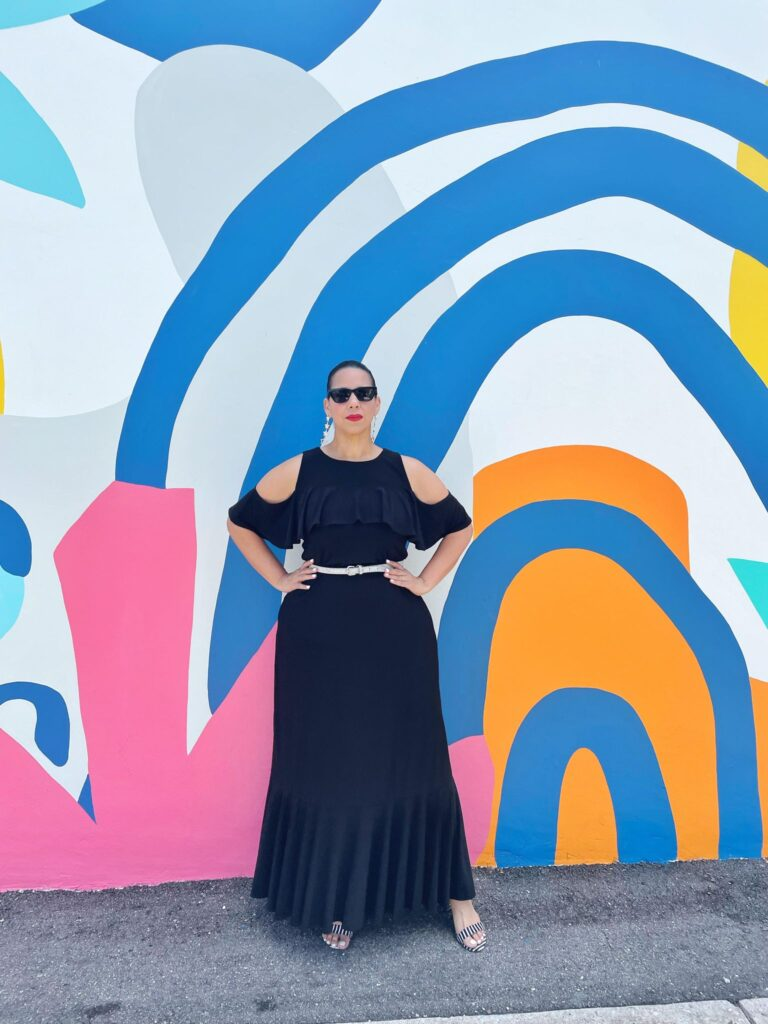 Farrah Estrella wearing a black dress by kiyonna