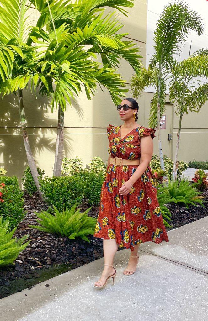 Fashion Blogger Farrah Estrella wearing an African print dress