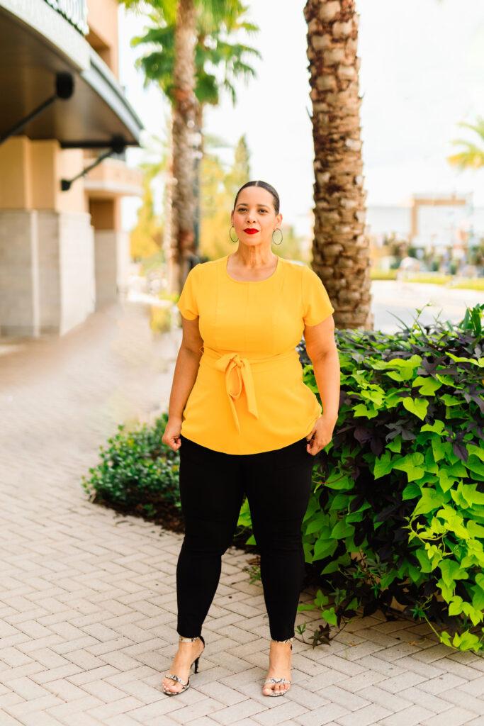 Yellow peplum top and black pants