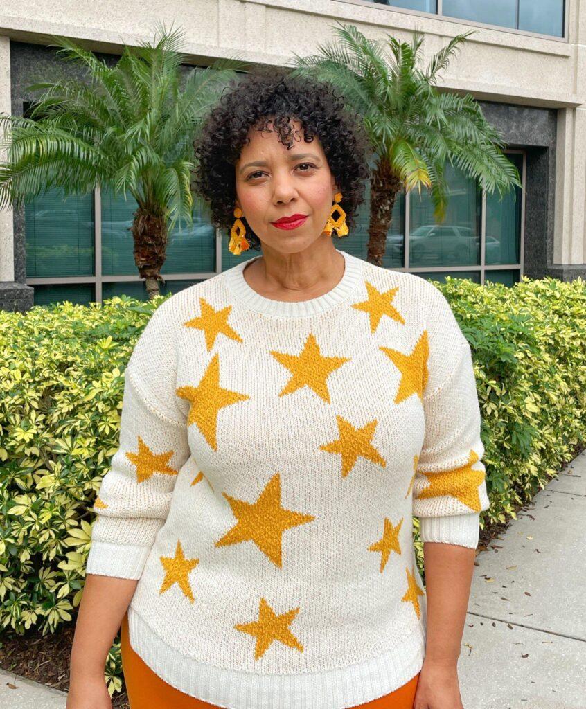 Tampa fashion blogger farrah estrella wearing a star print sweater